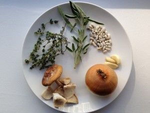 White bean soup with mushrooms sasge and herbs recipe photo