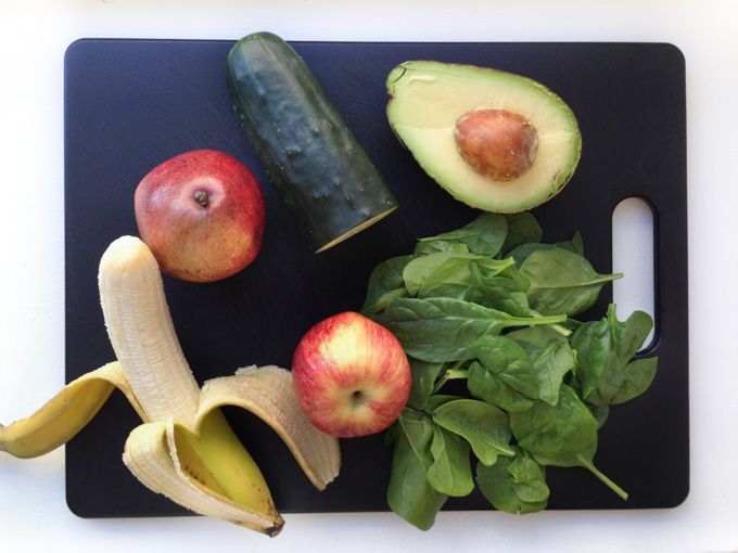 Ingredients for green smoothie recipe, fruit and greens, spinach and cucumber