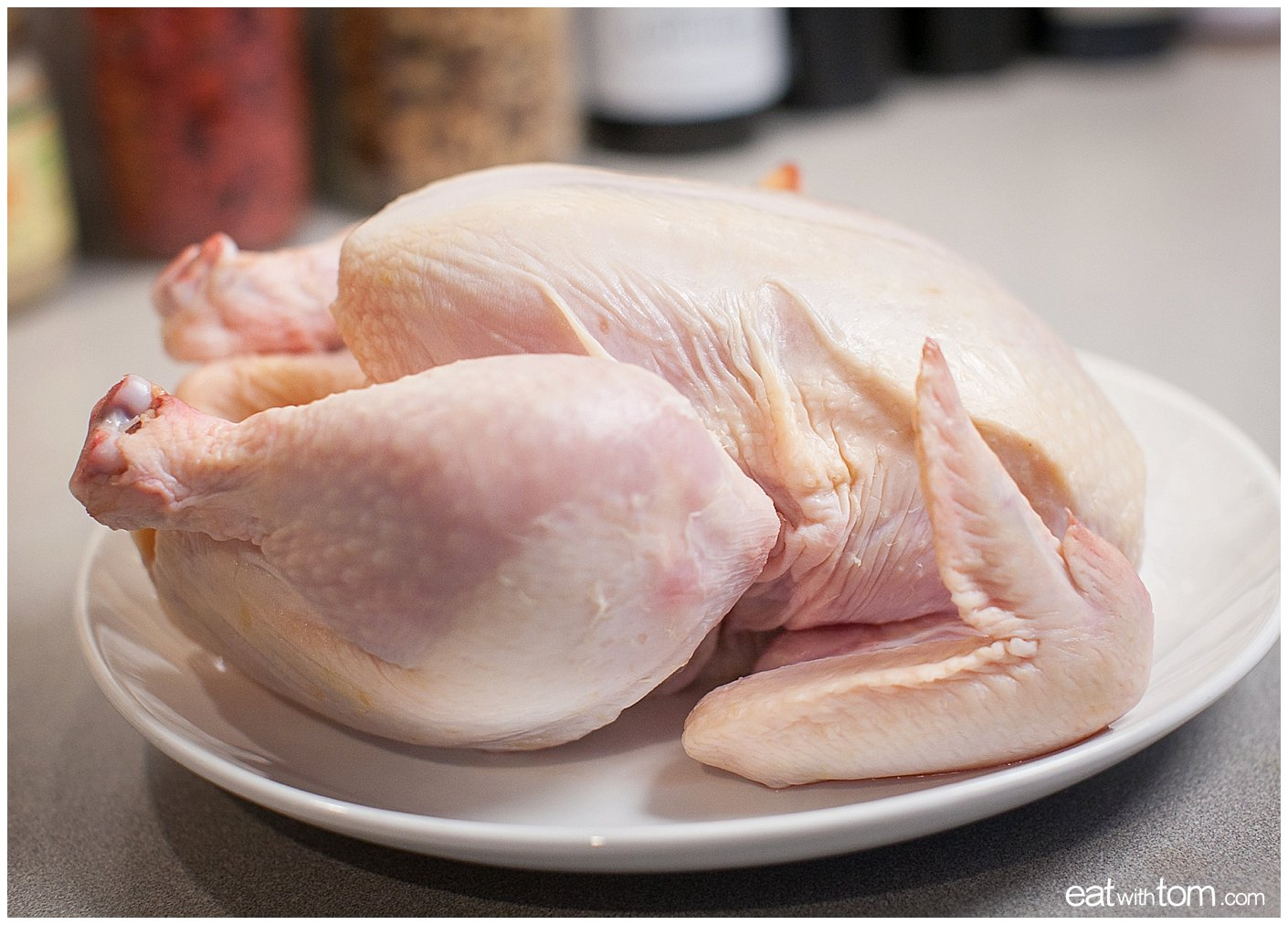 Prepare the raw chicken by wiping it dry