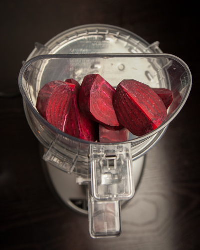 cuisinart food processor used to grate beets for vegan salad meal